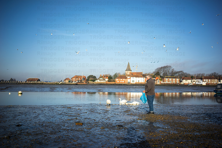 View across the estruary in Bosham looking towards old cottages in winter