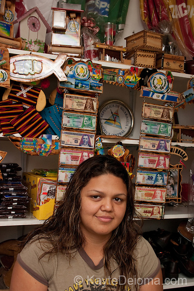 Guatemalan-American woman working in her aunt's shop, MiGuatemalaStore.com in Los Angeles, CA