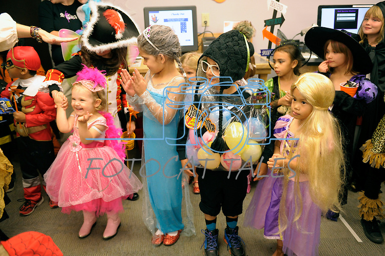 As part of the Carson City Library's Halloween festivities Monday, Oct. 27, 2014 children take part in a costume contest.