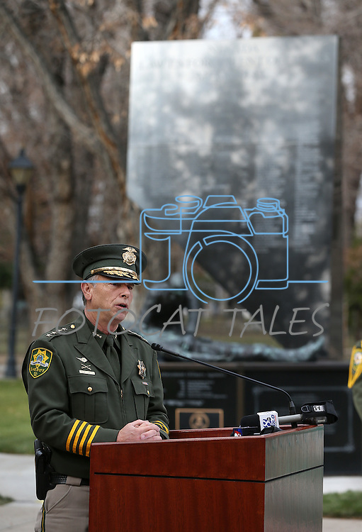 Sheriff Ken Furlong speaks at a ceremony to unveil a freeway sign dedicating I-580 in honor of Carson City Sheriff's Deputy Carl Howell at the Nevada Law Enforcement Officers Memorial in Carson City, Nev., on Tuesday, Dec. 8, 2015. Dep. Howell was killed in the line of duty on Aug. 15, 2015. <br /> Photo by Cathleen Allison