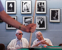 PHILADELPHIA - JULY 18:  Joseph Mastropaolo (L) and his brother Tony Mastropaolo (R) wait to play pool in an air conditioned Philadelphia Senior Center while cooling off from the heat at the July 18, 2006 in Philadelphia, Pennsylvania. Temperatures were expected to hit the upper 90's in the third day of a heat wave along the east coast. (Photo by William Thomas Cain/Getty Images)