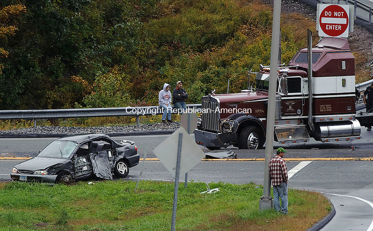 WATERBURY, CT -28 SEPTEMBER 2012--092812JS01- State and local police investigate an accident involving a car and a tractor trailer on the off I-84 off ramp at exit 17 and Chase Parkway in Waterbury on Friday. .Jim Shannon Republican-American