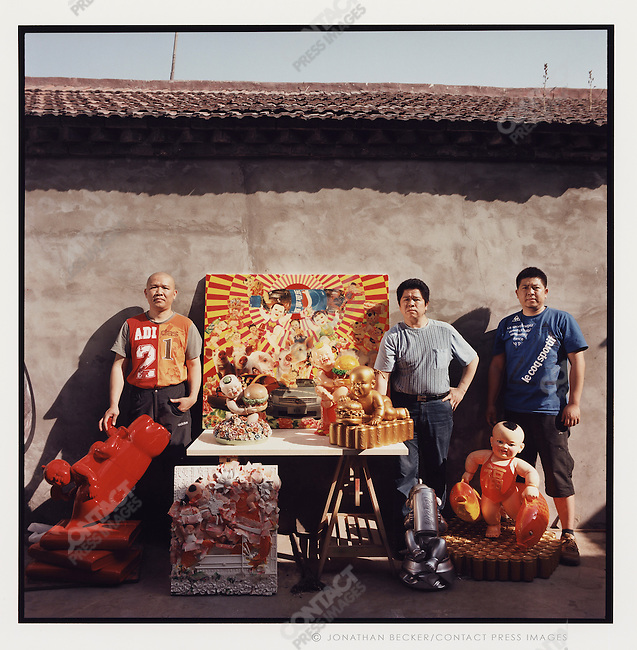 The Luo brothers with their recent work, Beijing, China, 2007.