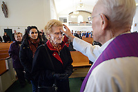 DOYLESTOWN, PA - FEBRUARY 18: An unidentified parishioner receives ashes on her forehead from retired Monsignor James Mortimer for Ash Wednesday at Our Lady of Mt. Carmel Catholic Church February 18, 2015 in Doylestown, Pennsylvania. (Photo by William Thomas Cain/Cain Images)