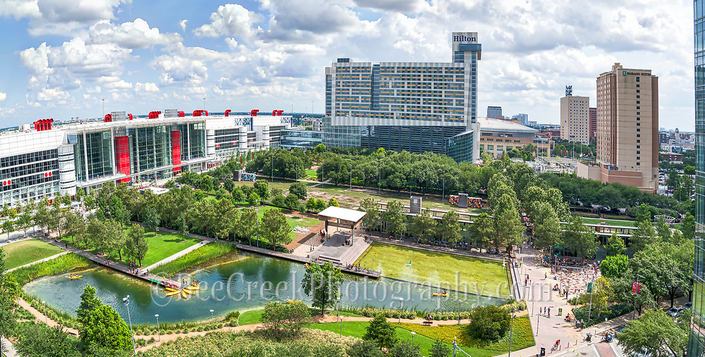 This is the Houston Discovery Green Park pano from this aerial vantage point which let us create this great pano overview of this area.  The Discovery Green park is 12 acreas right in the heart of downtown Houston across from the convention center, Toyota Center and Minute Maid Park a few blocks away.  There are also plenty of places to stay in the area with the the Hilton Americas and the new Marriott Marque to name just a few right across from the park. We loved that from this vantage point you could also see the George Brown Convention Center the high rise hotels and condos in the area along with the Kinder Lake and the childrens spray area for cooling down along with other areas of the park.  Along with the George Brown Convention Center they recently added Avenida Plaza and the Wing Over Water water sculptuer so you can spend a day just in this area of downtown Houston. There is parking garage under the park along with many other places to park and you can spend a day on Kinder lake kayaking or enjoy many movies, and music event at the Discovery Green free events while your here.  The convention center new Aveida also is a new place to come and listen to music.  While we were there people were dancing on the Aveida plaza to the latin beat of a Brazilian group next to the new water feature Wing Over Water right on this new area.  There is plenty to do, see and eat in the area so you don't have to go far.  The Discovery Green park in downtown  host over 600 free events for all ages every year you can beat that.