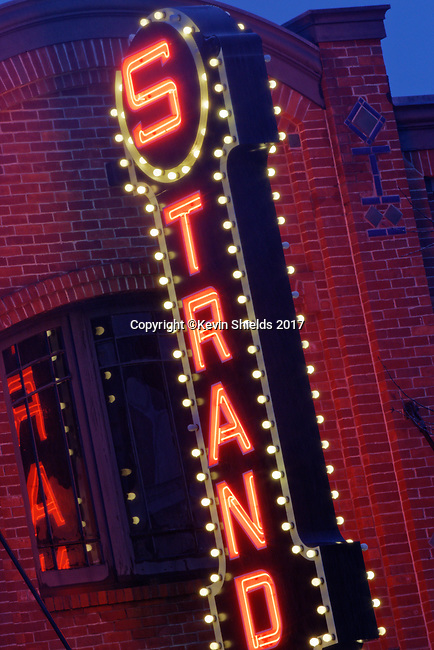 Twilight, evening, night, Rockland, Maine, USA, showing the Strand Theater.