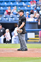 Home plate umpire Aaron Schorch before a game between the Rome Braves and the Asheville Tourists at McCormick Field on May 22, 2017 in Asheville, North Carolina. The Braves defeated the Tourists 7-3. (Tony Farlow/Four Seam Images)