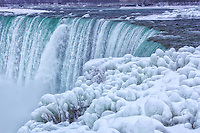 Looking along the brink of the wintery Canadian falls in Niagara.