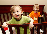 Cohen and Cooper in a crib in their room on Idlewood Drive in Charlottesville. Photo/Andrew Shurtleff