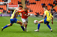 Blackpool's Kyle Vassell under pressure from Accrington Stanley's Matty Pearson (L) and Jordan Clark (R)<br /> <br /> Photographer Terry Donnelly/CameraSport<br /> <br /> The EFL Sky Bet League Two - Blackpool v Accrington Stanley - Friday 14th April 2017 - Bloomfield Road - Blackpool<br /> <br /> World Copyright &copy; 2017 CameraSport. All rights reserved. 43 Linden Ave. Countesthorpe. Leicester. England. LE8 5PG - Tel: +44 (0) 116 277 4147 - admin@camerasport.com - www.camerasport.com