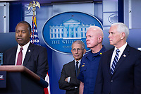 Director of the National Institute of Allergy and Infectious Diseases at the National Institutes of Health Dr. Anthony Fauci, Admiral Brett Giroir, United States Assistant Secretary for Health, and United States Vice President Mike Pence listen as United States Secretary of Housing and Urban Development (HUD) Ben Carson makes remarks on the Coronavirus crisis in the Brady Press Briefing Room of the White House in Washington, DC on Saturday, March 21, 2020. Credit: Stefani Reynolds / Pool via CNP/AdMedia