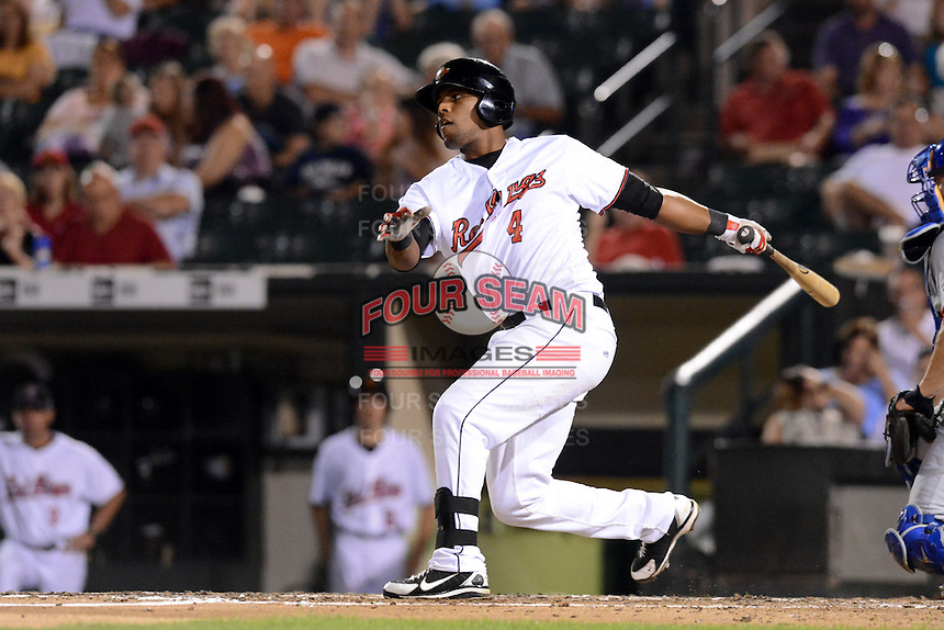 Rochester Red Wings third baseman Deibinson Romero (4) during a game against the Buffalo Bisons on August 30, 2013 at Frontier Field in Rochester, New York.  Buffalo defeated Rochester 6-3.  (Mike Janes/Four Seam Images)