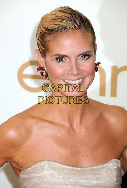 Heidi Klum (wearing Christian Siriano)  .63rd Primetime Emmy Awards held at Nokia Theatre L.A. Live. Los Angeles, California, USA. .18th September 2011.emmys headshot portrait strapless hair up red earrings.CAP/ADM/BP.©Byron Purvis/AdMedia/Capital Pictures.