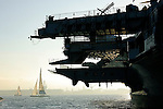 A silhouette of a partial view of the aircraft carrier  USS Midway museum in San Diego California.