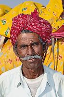 Camel driver portrait with his camel. Thar Desert, Jodhpur, India.