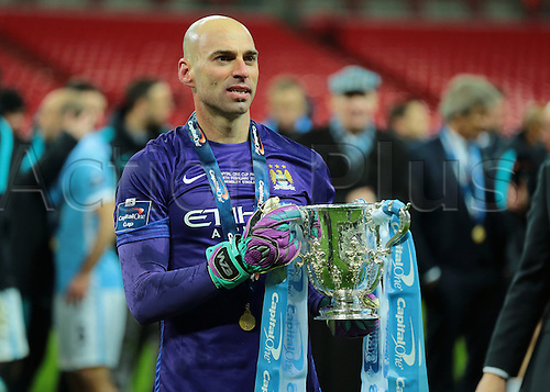 28.02.2016. Wembley Stadium, London, England. Capital One Cup Final. Manchester City versus Liverpool. Hero of the penalty shootout Manchester City Goalkeeper Wilfredo Caballero holds the Capital One Cup Trophy