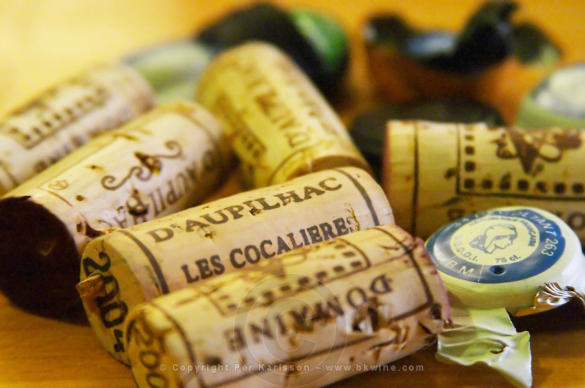 Domaine d'Aupilhac. Montpeyroux. Languedoc. Handful of corks on a table. France. Europe.