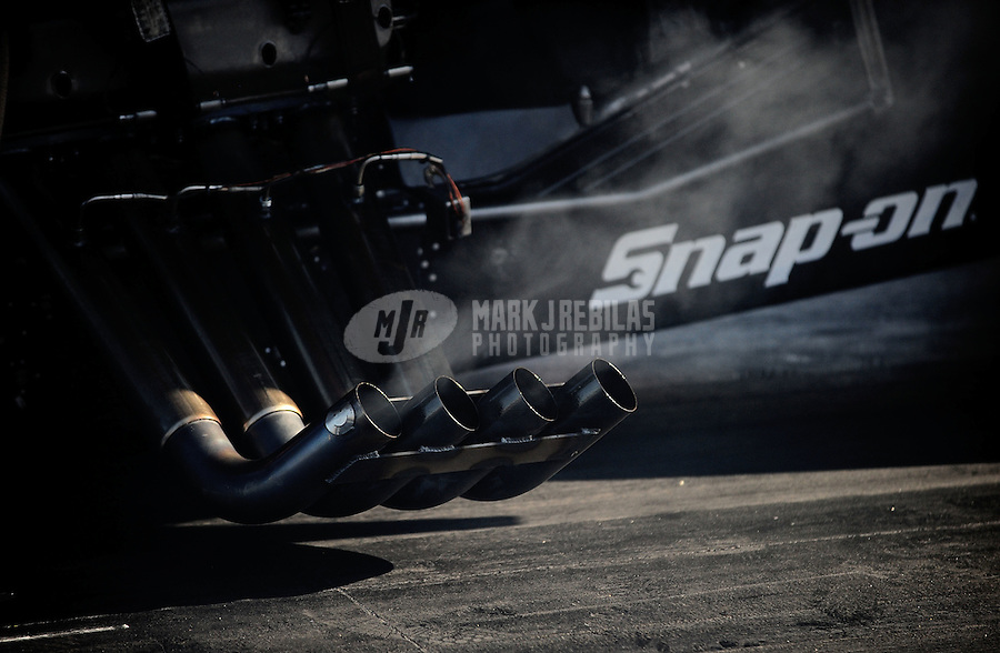 Sept. 19, 2010; Concord, NC, USA; Detailed view of the header exhaust pipe on the car of NHRA funny car driver Cruz Pedregon during the O'Reilly Auto Parts NHRA Nationals at zMax Dragway. Mandatory Credit: Mark J. Rebilas-