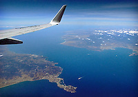 The Strait of Gibraltar seen from the plane. At the narrowest point Spain (on the right side in the image) is not more than 14 kilometres away from Morocco.
