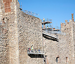 Stonemasons doing maintenance repairs to the stone walls of Framlingham castle, Suffolk, England