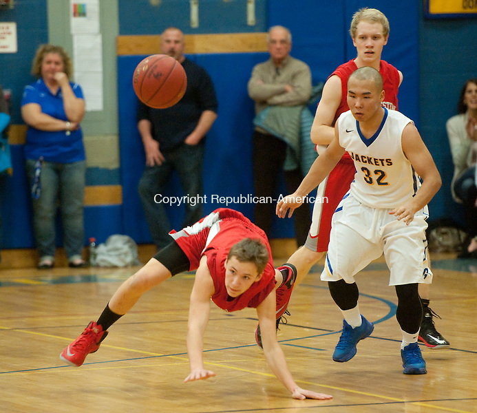 WINSTED, CT--- -011516JS15--Gilbert's Archie Aoerquilong (32) is called with a foul after colliding with Northwestern's Chris Nanni (5) while they both go for a loose ball during their game Friday at the Gilbert School in Winsted. <br />  Jim Shannon Republican-American