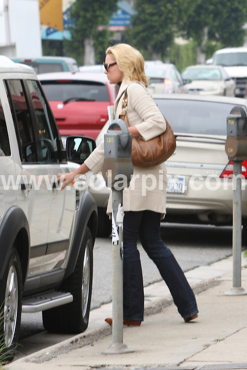 **ALL ROUND EXCLUSIVE PICTURES FROM SOLARPIX.COM**.**WORLDWIDE SYNDICATION RIGHTS**.**NO PUBLICATION IN AUSTRALIA, NEW ZEALAND,.DENMARK, GERMANY OR USA**.the Grey's Anatomy star Katherine Heigl and her mother spent the day shopping and she is seen holding a 1$ bill with a catalog for columnar pads? Los Angeles, USA. 11th September 2008..This pic: Katherine Heigl..JOB REF: 7297 LAP       DATE: 11_09_2008.**MUST CREDIT SOLARPIX.COM OR DOUBLE FEE WILL BE CHARGED* *UNDER NO CIRCUMSTANCES IS THIS IMAGE TO BE REPRODUCED FOR ANY ONLINE EDITION WITHOUT PRIOR PERMISSION*