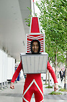 May 22, 2011, Tokyo, Japan - A man wears the Tokyo Tower costume. Tokyo Skytree, the world's tallest self-standing telecommunications tower with a height of 634 meters, opens today. This new Japanese landmark is expected to attract approximately 200,000 visitors on this first official opening day to the general public. (Photo by Yumeto Yamazaki/Nippon News)