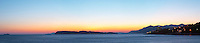 Sunset over the sea. Wide panorama with view over the islands Daksa and others. House lights. Uvala Sumartin bay between Babin Kuk and Lapad peninsulas. Dubrovnik, new city. Dalmatian Coast, Croatia, Europe.