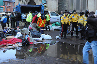 November 23, 2011, Police, protesters and media people watch as city workers remove garbage. Toronto Police arrived in significant numbers this morning, beginning the process of evicting the Occupy Toronto tent camp from St. James Park.