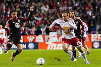 Marcelo Saragosa (11) of D. C. United and Joel Lindpere (20) of the New York Red Bulls. D. C. United defeated the New York Red Bulls 1-0 (2-1 in aggregate) during the second leg of the MLS Eastern Conference Semifinals at Red Bull Arena in Harrison, NJ, on November 8, 2012.