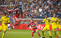 Chicago defender Jalil Anibaba (6) heads a shot on goal.  The Chicago Fire defeated the Columbus Crew 2-1 at Toyota Park in Bridgeview, IL on June 23, 2012.