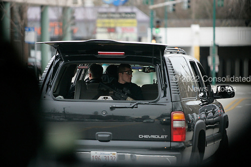 Chicago, IL - November 22, 2008 -- Security behind United States President-Elect Barack Obama's motorcade as he heads to his morning working in the Hyde Park neighborhood of Chicago, Saturday, November 22, 2008..Credit: Anne Ryan - Pool via CNP