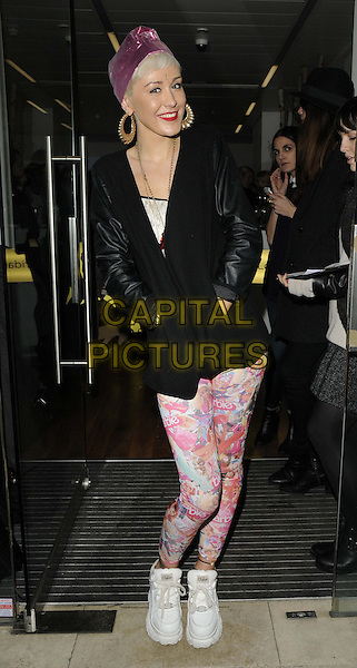 Syron ( Daisy Tullulah Syron Russell ).attended the Casio Tokyo Trio Watch launch party, The Study, Blandford St., London, England..January 28th, 2013.full length black jacket leather sleeves pink leggings hands in pockets white trainers sneakers hairband headband.CAP/CAN.©Can Nguyen/Capital Pictures.