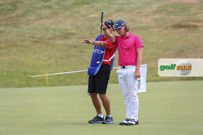 Kristoffer Broberg (SWE) trying to read the putt on 16 during Round Three of the 2015 Alstom Open de France, played at Le Golf National, Saint-Quentin-En-Yvelines, Paris, France. /04/07/2015/. Picture: Golffile | David Lloyd<br /> <br /> All photos usage must carry mandatory copyright credit (&copy; Golffile | David Lloyd)