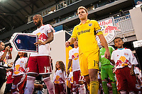 Thierry Henry (14) of the New York Red Bulls and Chad Marshall (14) of the Columbus Crew lead their teams onto the field. The New York Red Bulls defeated the Columbus Crew 3-1 during a Major League Soccer (MLS) match at Red Bull Arena in Harrison, NJ, on September 15, 2012.