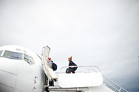SAN JOSE, CA--Senior Grace Mashore enters the charter plane at Atlantic Aviation en route to Norfolk, VA for the first and second rounds of the 2012 NCAA tournament.