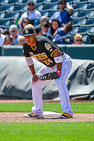 Jefry Marte (24) of the Salt Lake Bees on defense against the El Paso Chihuahuas in Pacific Coast League action at Smith's Ballpark on April 24, 2016 in Salt Lake City, Utah. This was Game 1 of a double-header.  El Paso defeated Salt Lake 7-0. (Stephen Smith/Four Seam Images)