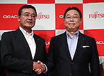 July 6, 2016, Tokyo, Japan - Japanese computer giant Fujitsu chairman Masami Yamamoto (L) shakes hands with Oracle Japan president Hiroshige Sugihara at a press conference in Tokyo on Wednesday, July 6, 2016 as Fujitsu and American cloud database service giant Oracle agreed to form a new strategic alliance to deliver enterprise cloud services to customers in Japan.  (Photo by Yoshio Tsunoda/AFLO) LWX -ytd-