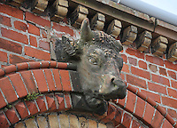 Bull figurehead on a traditional cattle market building, Lockerbie.....Copyright..John Eveson, Dinkling Green Farm, Whitewell, Clitheroe, Lancashire. BB7 3BN.01995 61280. 07973 482705.j.r.eveson@btinternet.com.www.johneveson.com