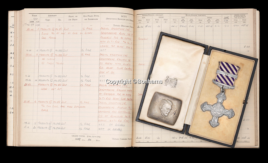 BNPS.co.uk (01202 558833)Pic: Bonhams/BNPSWolstenholme's DFC.The bravery medals and logbooks of Kenneth Wolstenholme have emerged for sale which reveal it was almost 'all over' for the legendary commentator 25 years before he said the immortal line during the 1966 World Cup Final.Wolstenholme will always be remembered for leaving his mark on the greatest day in English football history with his commentary of Geoff Hurst's hat-trick goal which sealed England's only World Cup win.But he was also an exceptional pilot who flew in 89 raids in the Second World War - another famous victory over Germany.However, it has now come to light that he was almost killed during one of his first missions, a raid on Heligoland, a small German archipelago in the North Sea, on May 21, 1941.