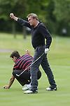 Phillip Glenister celebrates after holing a putt on the 3rd hole.<br /> Celebrity Cup Golf<br /> Celtic Manor Resort<br /> 04.07.14<br /> &copy;Steve Pope-SPORTINGWALES