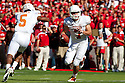 October 16, 2010: Texas Longhorns quarterback Garrett Gilbert #7 reaches out to fake a reverse and runs in for a touchdown against the Nebraska Cornhuskers in the first quarter at Memorial Stadium in Lincoln, Nebraska. Texas defeated Nebraska 20 to 13.