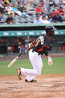 Adeiny Hechavarria (3) of the Miami Marlins at bat during a Grapefruit League Spring Training game at the Roger Dean Complex on March 24, 2014 in Jupiter, Florida. Washington defeated Miami 4-1. (Stacy Jo Grant/Four Seam Images)