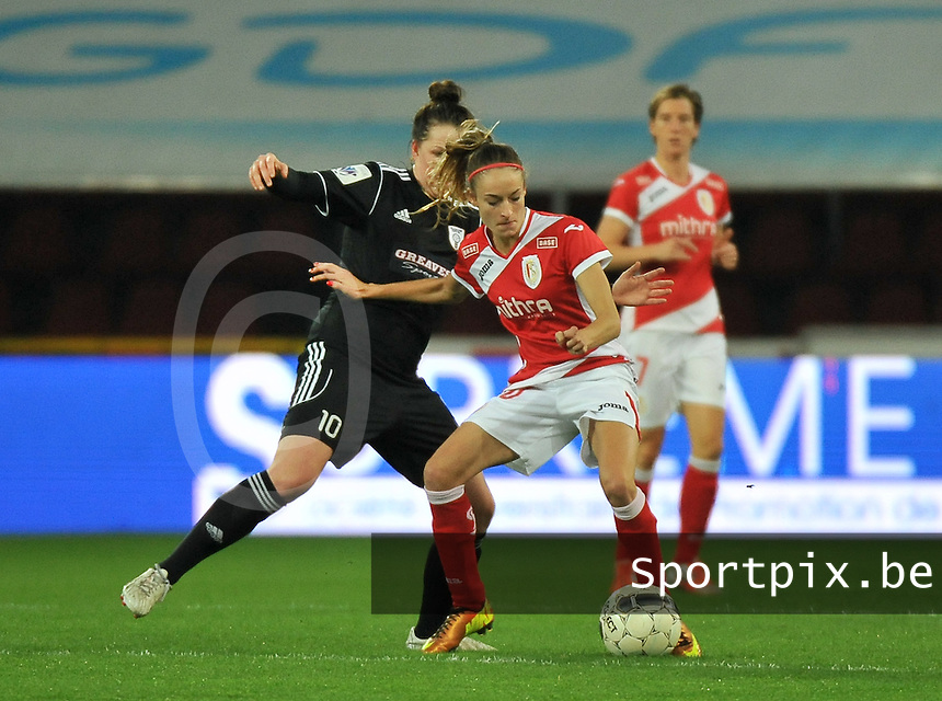 20131009 - LIEGE , BELGIUM : Standard's Tessa Wullaert  (right) pictured with Glasgow Suzanne Lappin (left) during the female soccer match between STANDARD Femina de Liege and  GLASGOW City LFC , in the 1/16 final ( round of 32 ) first leg in the UEFA Women's Champions League 2013 in stade maurice dufrasne - Sclessin in Liege. Wednesday 9 October 2013. PHOTO DAVID CATRY