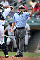 Home plate umpire Matt McCoy asks for three baseballs during a game between the Mississippi Braves and Montgomery Biscuits on April 22, 2014 at Riverwalk Stadium in Montgomery, Alabama.  Mississippi defeated Montgomery 6-2.  (Mike Janes/Four Seam Images)