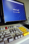 Computer keyboard and computer screen displaying Mac-Lab and GE Medical Systems logo... Royalty Free
