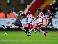 Stevenage's Michael Timlin passes under pressure from Lincoln City's Harry Anderson<br /> <br /> Photographer Andrew Vaughan/CameraSport<br /> <br /> The EFL Sky Bet League Two - Stevenage v Lincoln City - Saturday 8th December 2018 - The Lamex Stadium - Stevenage<br /> <br /> World Copyright © 2018 CameraSport. All rights reserved. 43 Linden Ave. Countesthorpe. Leicester. England. LE8 5PG - Tel: +44 (0) 116 277 4147 - admin@camerasport.com - www.camerasport.com