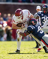 Hawgs Illustrated/BEN GOFF <br /> Cole Kelley, Arkansas quarterback, tries to break the tackle of DeMarquis Gates, Ole Miss linebacker, on a keeper in the third quarter Saturday, Oct. 28, 2017, at Vaught-Hemingway Stadium in Oxford, Miss.
