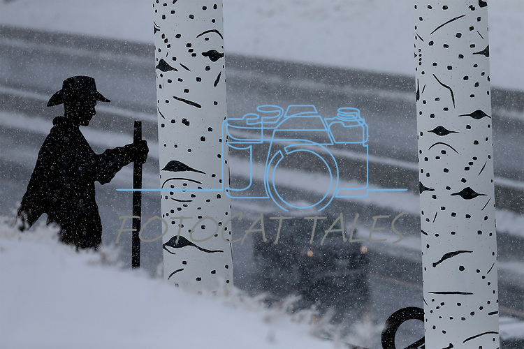 Traffic moves past highway artwork of a Basque sheepherder during a snowstorm in Carson City, Nev., on Friday, March 16, 2018. <br />Photo by Cathleen Allison/Nevada Momentum