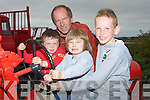 TRACTOR: Looking over one of the vintage tractors on display at the Blennerville Trashing Fair, on Sunday were, Daniel and Sean Cronin and Fionn Coleman (Tralee) and Eoin Buckley (Learachrompane)...................